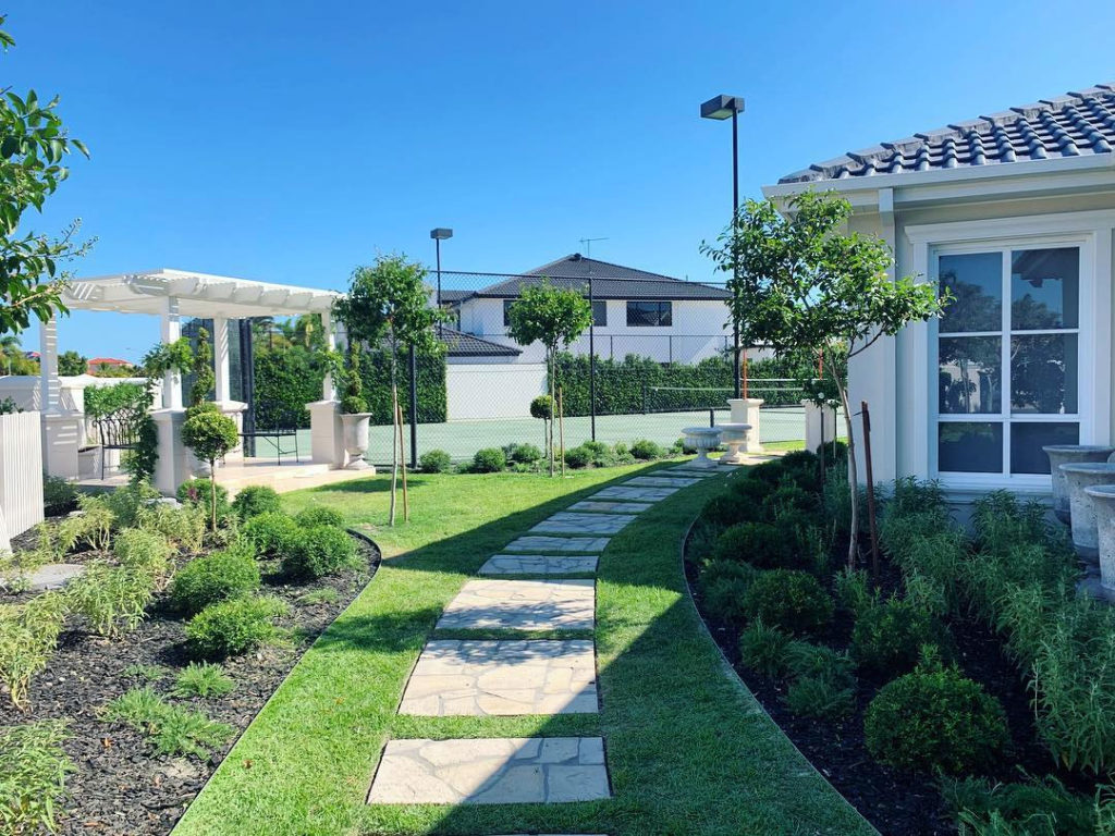 Top dress the lawn to match the height of your pavers. Gardener Melbourne