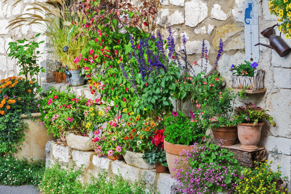 Rural house decorated with flowers in pots, Gourdon France