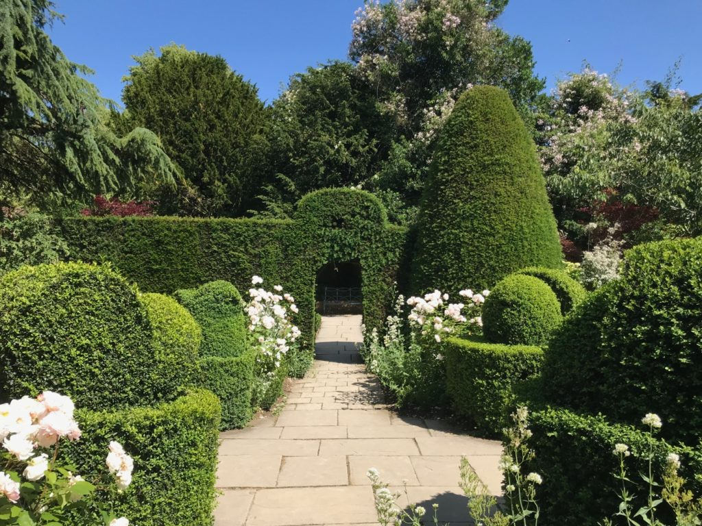 Neat hedge and stone landscaping of paths with topiary Yew hedges Cottage Garden ideas