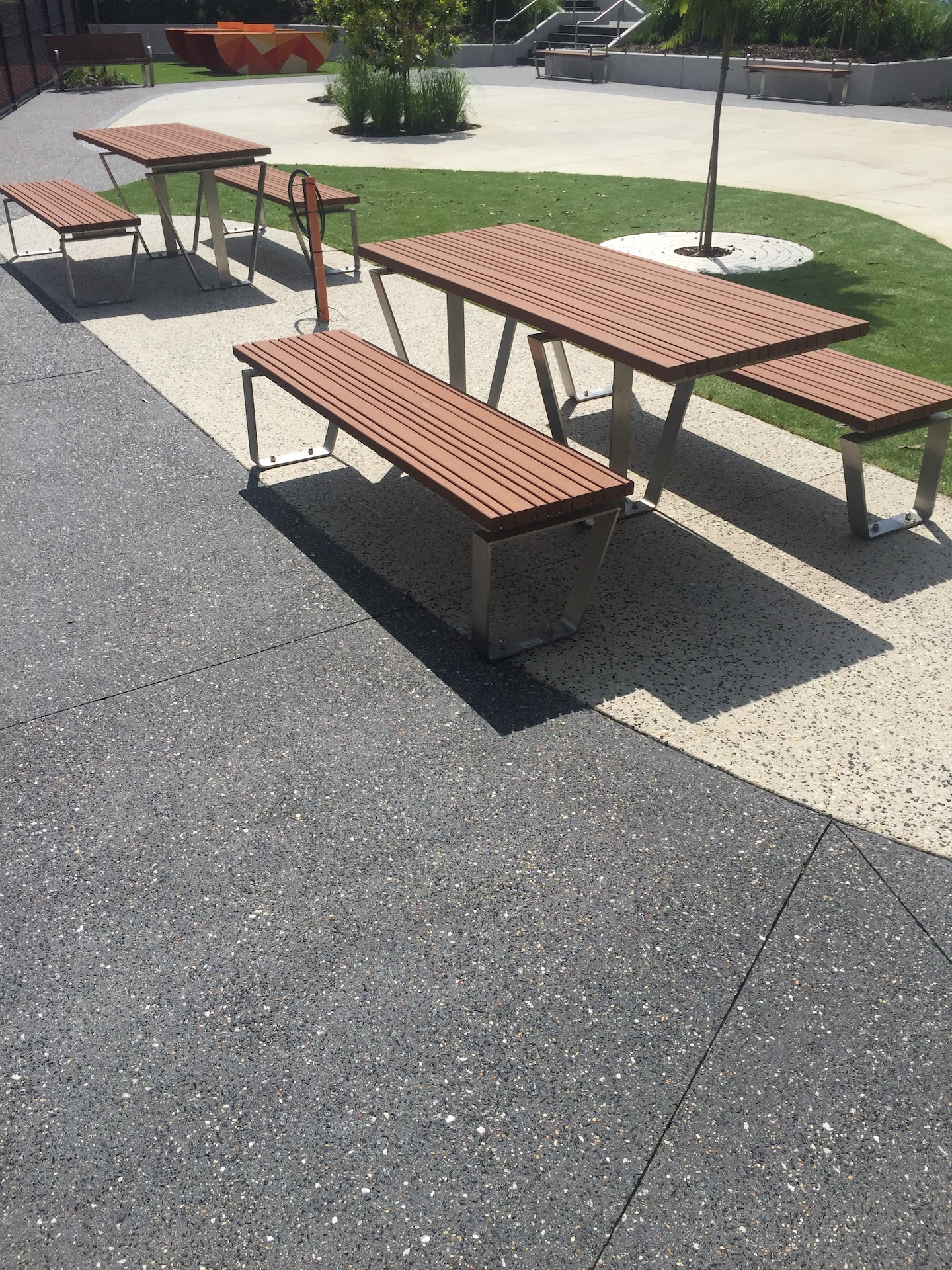 Outdoor Furniture on Exposed aggregate concrete. Commercial Landscaping at Balwyn Community Centre