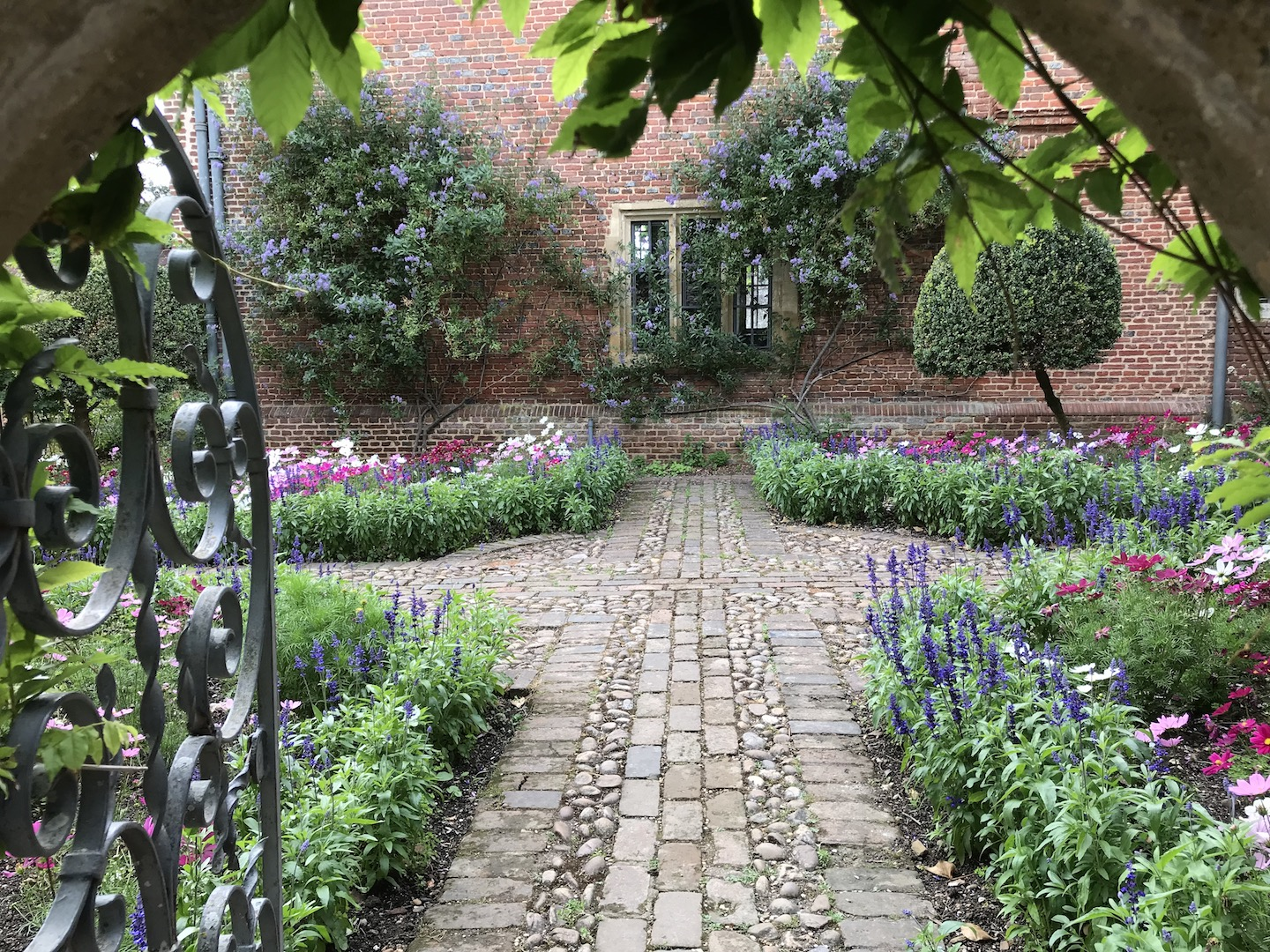 Crossed brick and Pebble Pathway with herbaceous borders.