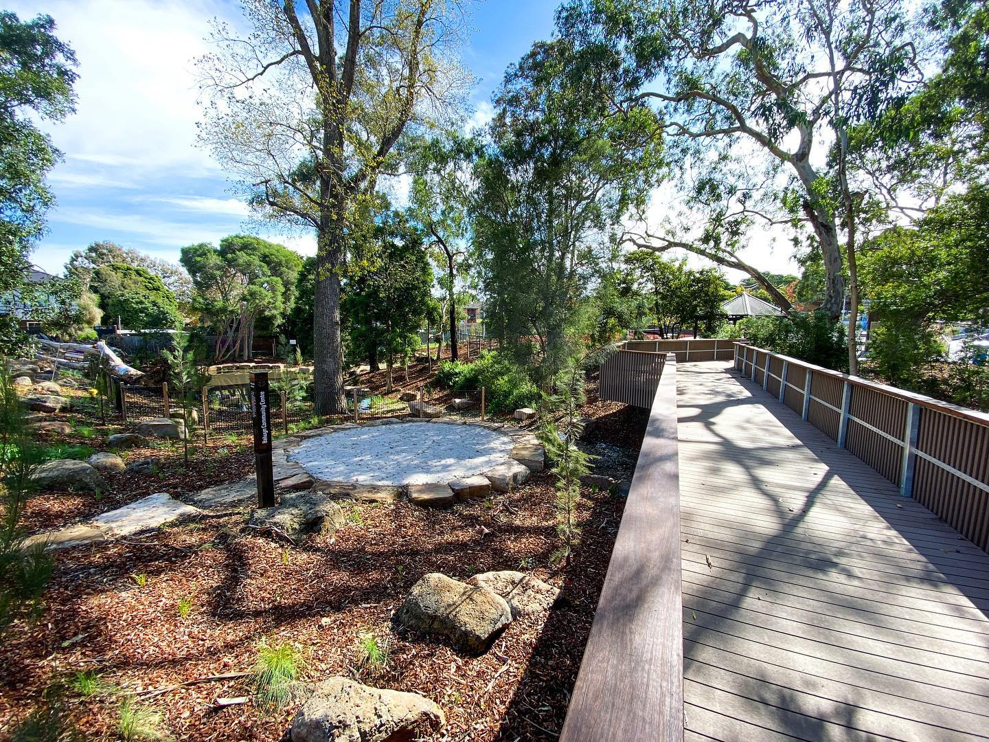 A boardwalk runs past the yoga mat and the urban wetlands. Balwyn Community Centre.