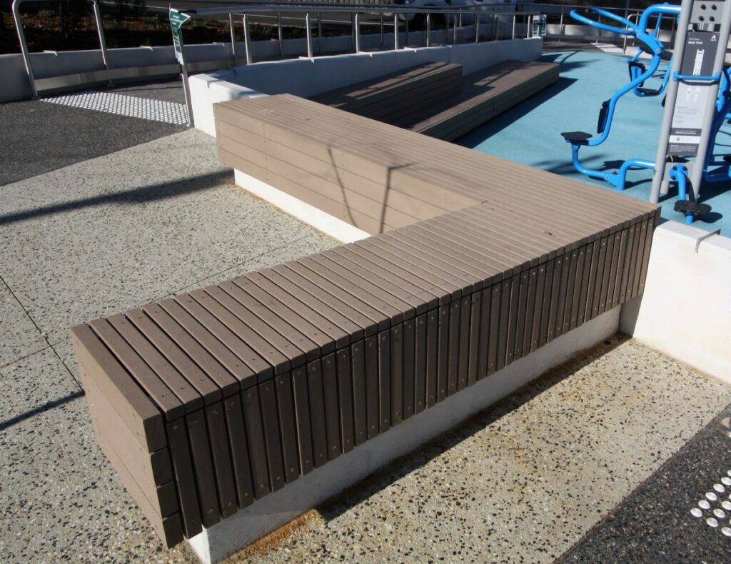 Composite Plastic Enviroslat Bench with cast in-situ concrete base.