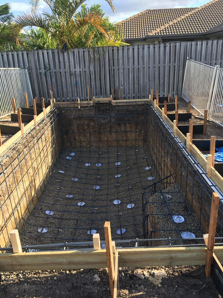 Concrete swimming pool reinforcement for a shallow pool.