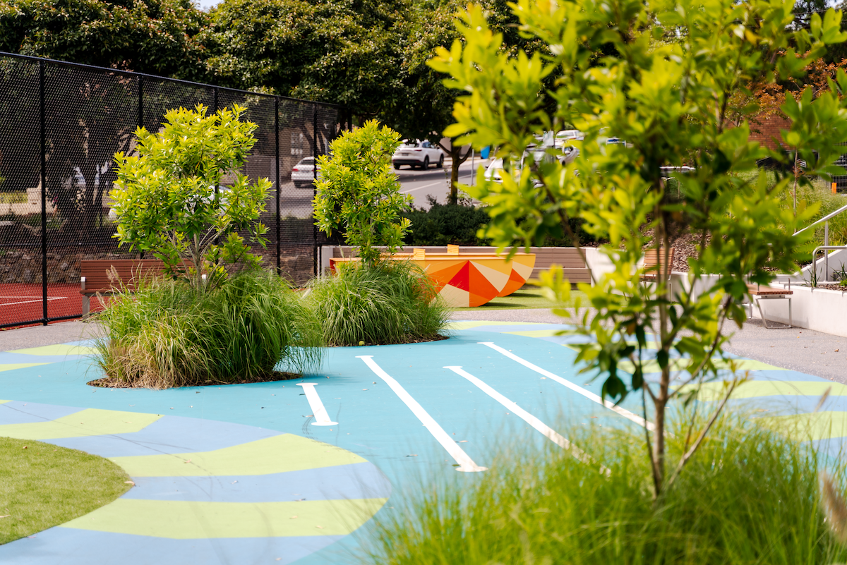Commercial landscaping with a children's play area.