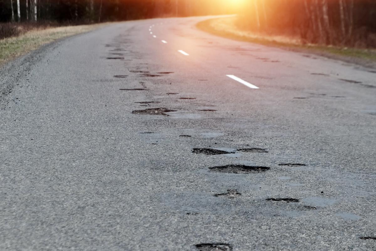 pot holed asphalt roads